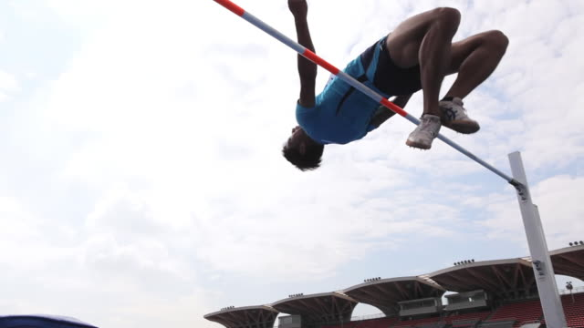 MS LA TS Shot of Male high jumper clearing bar / Tokyo, Japan
