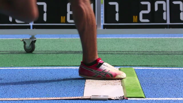 ms shot of male long jumper running and jumping / tokyo, japan - salto in lungo video stock e b–roll