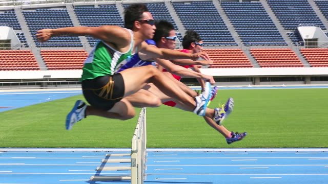 ms shot of male runners jumping hurdles in race / tokyo, japan - lockdown viewpoint stock videos & royalty-free footage