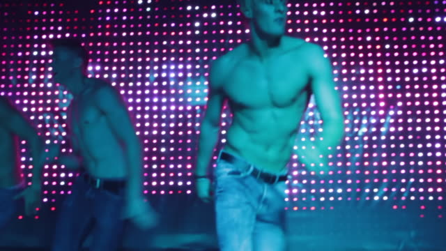 cu ts la shot of male strippers dancing / london, united kingdom - strip stock-videos und b-roll-filmmaterial
