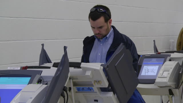 MS Shot of male voter casts ballot at copmuter terminal during voting in presidential election / Sylvania, Ohio, United States