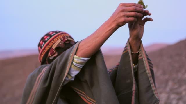 CU ZO Shot of mam showing Native ritual AUDIO / South Of Peru, Nazca, Peru