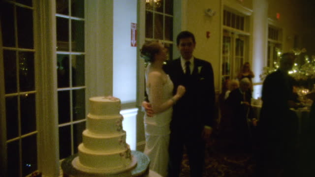 vidéos et rushes de ms shot of man and woman kiss at wedding reception / new york, united states  - costume complet