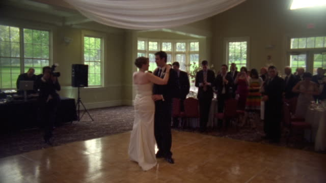 WS Shot of Man and woman slow dance together at wedding reception / New York, United States