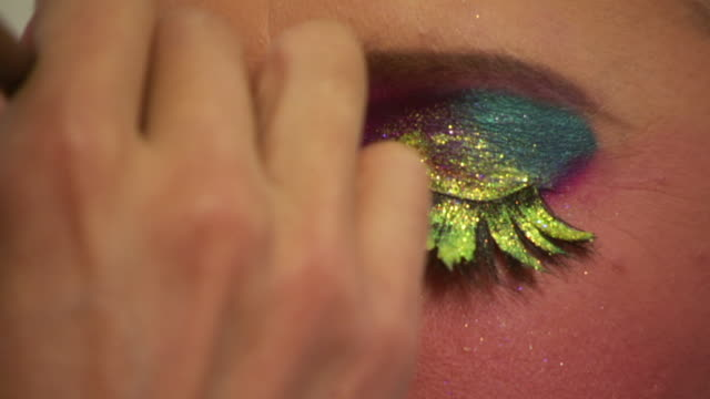 ECU Shot of Man applies colorful glittery eye makeup / Washington, Dist. of Columbia, United States