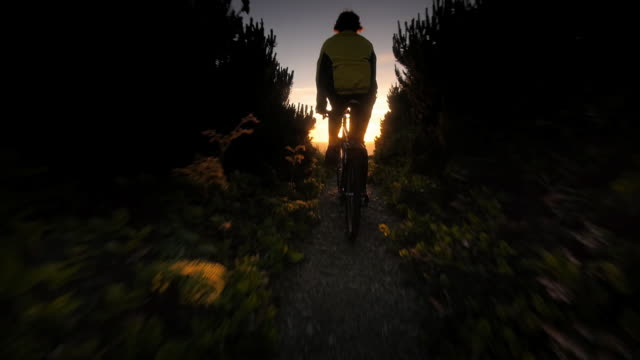 ms slo mo pov shot of man bicycling on trail overlooking ocean / port orford heads state park, oregon, united states - oregon us state stock videos & royalty-free footage