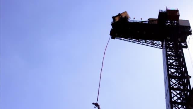 ms slo mo shot of man bungee jumping at namyangju / gyeonggi=do, south korea  - high up stock videos & royalty-free footage