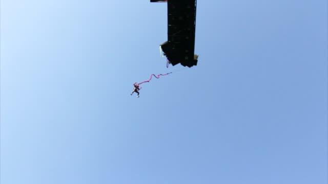 MS SLO MO Shot of Man Bungee Jumping at Namyangju / Gyeonggi=do, South Korea