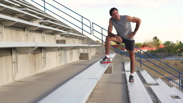 ms tu shot of man cooling down after workout on steps / santa fe, new mexico, united states - scale video stock e b–roll