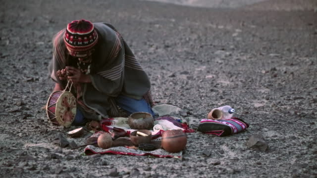MS Shot of man doing Native ritual AUDIO / South Of Peru, Nazca, Peru