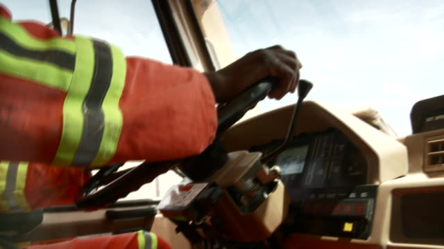 CU Shot of man driving construction vehicle / Namibia