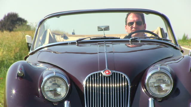 ms pov shot of man driving with oldtimer through landscape / saarburg, rhineland palatinate, germany - classic car stock videos and b-roll footage