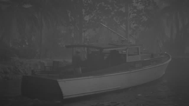 ms pan shot of man entering for boat - fischerboot stock-videos und b-roll-filmmaterial