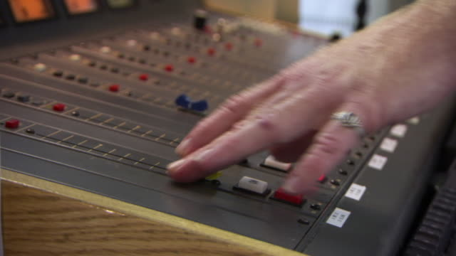 cu r/f shot of man hands on playing with controls of sound mixer / dublin, georgia, united states - radio broadcasting stock videos and b-roll footage
