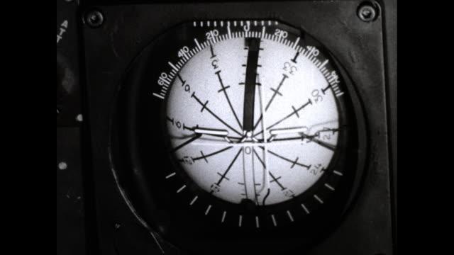 vídeos de stock, filmes e b-roll de shot of man in cockpit maneuvering stick shift close up of his face still shot of the control panel shot of compass shot of panel of lights - compasso