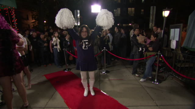 ws zi zo shot of man in drag cheerleader costume poses on red carpet during high heel race in dupont circle / washington, dist. of columbia, united states - drag queen stock videos and b-roll footage