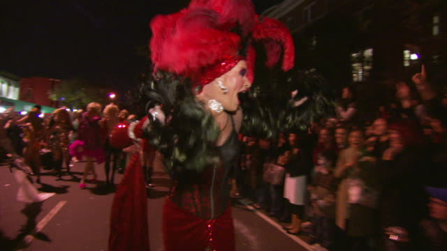 WS POV TU TD Shot of man in drag costume running during high heel race in DuPont Circle / Washington, Dist. of Columbia, United States