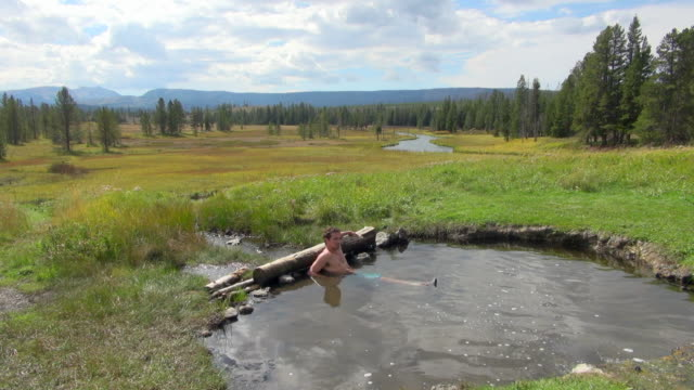 Shot of Man Just Finishing Relaxing Bath in Hot Spring