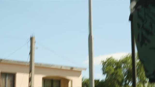 vidéos et rushes de ms tu td shot of man looking at big fidel sign town / cuba - révolution cubaine