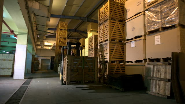 WS SLO MO Shot of man on fork lift moving pallets of wine / ElGouna, RED Sea, Egypt