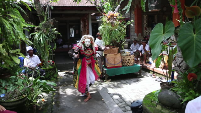 MS Shot of man performing with mask on / Ubud, Bali, Indonesia