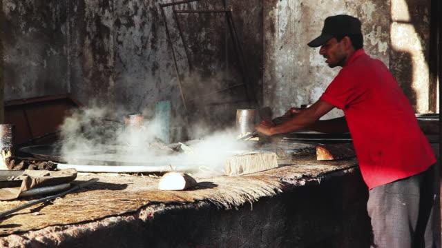 ms shot of man preparing food / hyderabad, andhra pradesh, india - お玉点の映像素材/bロール