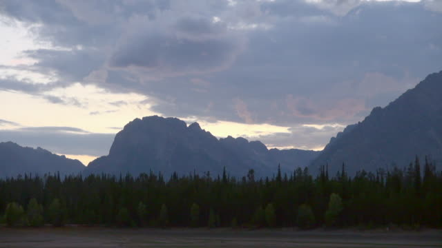 Shot of Man Showing Beauty of Grand Teton National Park
