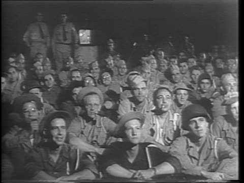 shot of man turning on movie projector with reel spinning / wide shots of us soldiers viewing first run feature films / close up shots of soldiers... - projection equipment stock videos & royalty-free footage