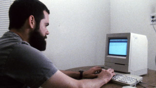 ms shot of man typing on 1980s era mac computer / new york , united states - 1980 stock videos & royalty-free footage