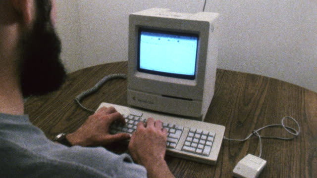 ms shot of man typing on 1980s era  mac computer / new york , united states - 1980 stock videos and b-roll footage