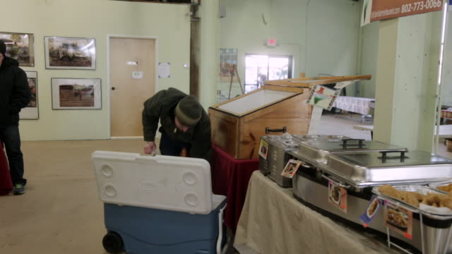 MS Shot of man Unloading food from cooler / Rutland, Vermont, United States