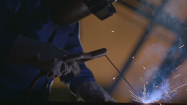 MS TU R/F Shot of Man welding metal