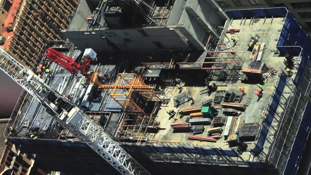 WS T/L Shot of Manual workers constructing sky scraper / Sydney, New South Wales, Australia