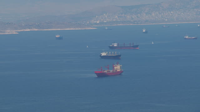 ms aerial shot of many freighters and sailboats on ocean / piraeus, peloponnese, greece - greece stock videos & royalty-free footage