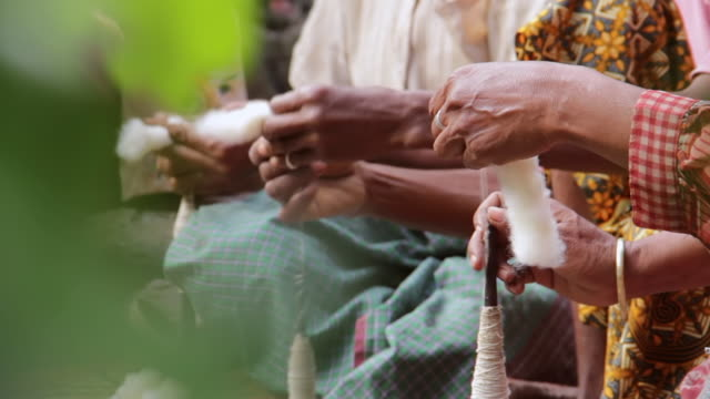 ms shot of many hands spinning yarn / soe, mt. mutis, west timor indonesia - ball of wool stock videos & royalty-free footage