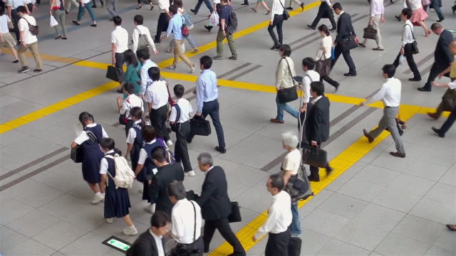 ms shot of many people exiting train station in morning in shinagawa / tokyo, japan - japanese school uniform stock videos & royalty-free footage
