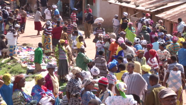 ms shot of many people walking at outdoor marketplace / bwindi, kabale, uganda - ウガンダ点の映像素材/bロール