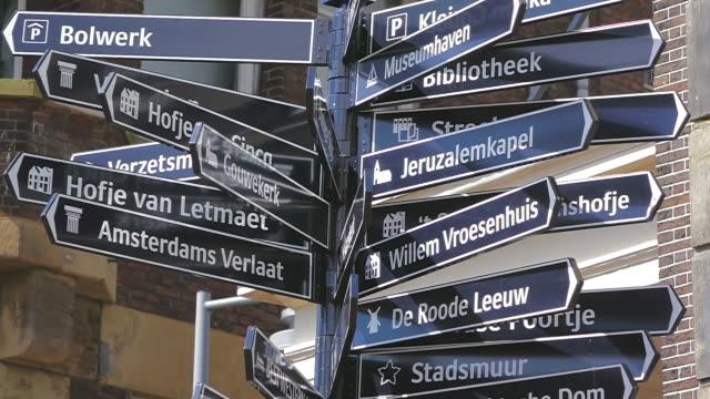vídeos de stock, filmes e b-roll de cu shot of many sign boards / south holland, netherlands - placa de estrada