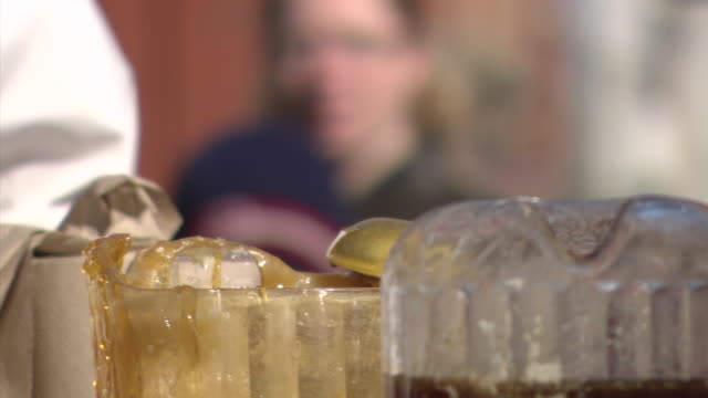 cu shot of maple candy made on ice / quebec, canada - karamell stock-videos und b-roll-filmmaterial