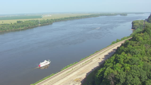 ms aerial shot of mark twain riverboat traveling south on mississippi river along west bank of river / hannibal, missouri, united states - mark twain stock videos & royalty-free footage