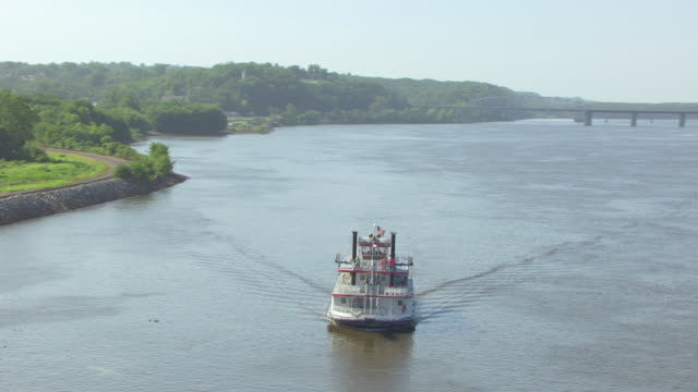 ms aerial ts zi shot of mark twain riverboat with tourists aboard traveling down mississippi river / hannibal, missouri, united states - mark twain stock videos & royalty-free footage