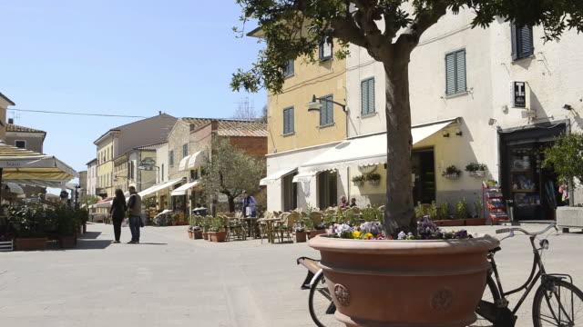MS Shot of Market place with Restaurants / Castiglione della Pescaia, Tuscany, Italy