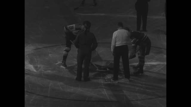Shot of marquee above entrance to Maple Leaf Gardens / before game several shots in locker room of members of Toronto Maple Leafs getting ready for...