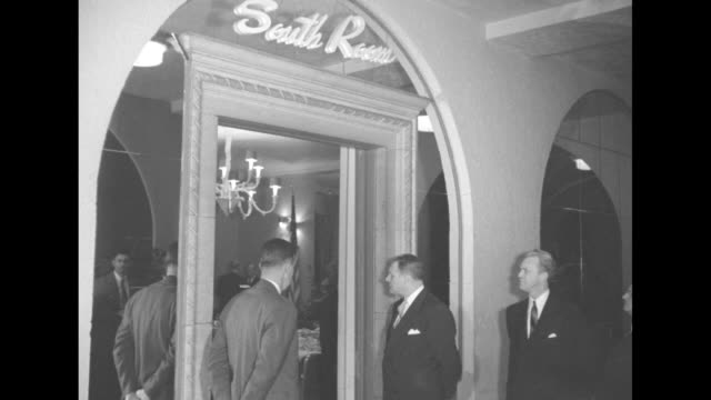shot of marquee in front of hotel commodore / four shots of men standing around entrance and leaving entrance to room in hotel where presidentelect... - generalstaatsanwalt stock-videos und b-roll-filmmaterial