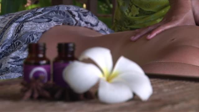 cu r/f shot of massage / bunaken national park, sulawesi island, indonesia    - spa treatment stock videos & royalty-free footage