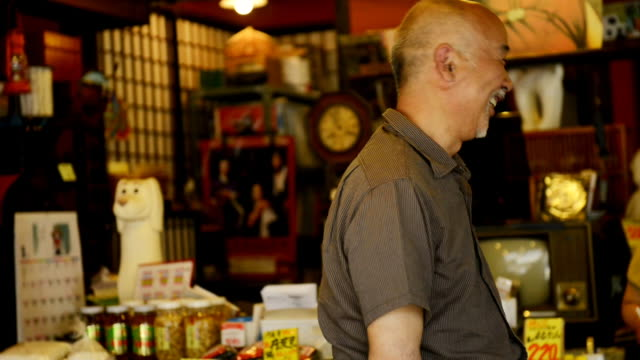stockvideo's en b-roll-footage met ms shot of master of greengrocer is a salesperson / toyooka, hyogo, japan - kruidenier