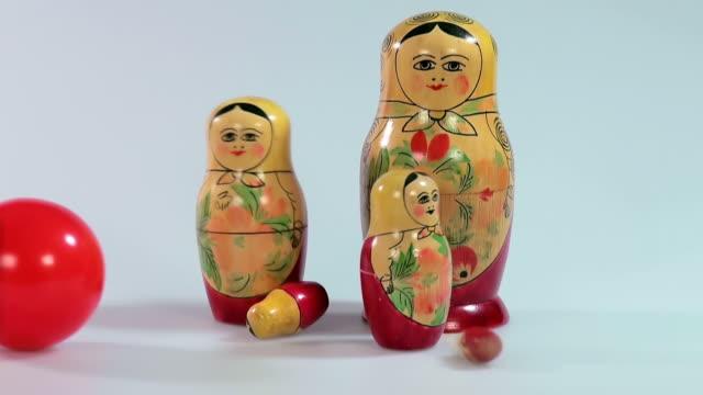 ms shot of matryoshka dolls with boll, russian dolls / saarburg, rhineland palatinate, germany - female likeness stock videos & royalty-free footage