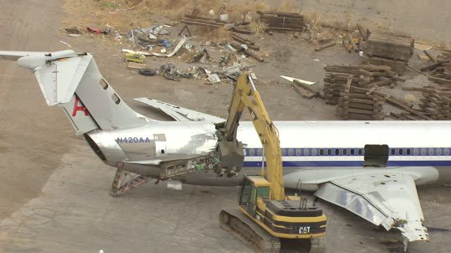 ms aerial zi ts shot of md80 commercial jet airliner claw tears off tail of airplane / roswell, new mexico, united states - roswell stock videos & royalty-free footage