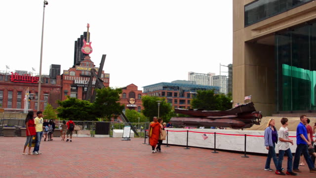 ws shot of memorial baltimore maryland inner harbor for 9/11 deaths of baltimore people steel girders from world trade center in new york city with people walking area / baltimore, maryland, united states - september 11 2001 attacks stock videos & royalty-free footage