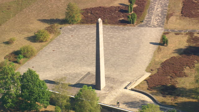 MS AERIAL Shot of Memorial Obelisk at Bergen Belsen / Germany